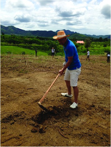 A man woking on the soil